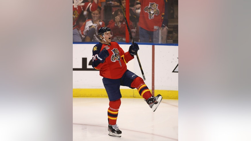 Florida Panthers' Sean Bergenheim (20) celebrates the first of his two second period goals during the NHL hockey game in Sunrise, Fla., Monday, Nov. 25, 2013 against the Philadephia Flyers. (AP Photo/J Pat Carter)