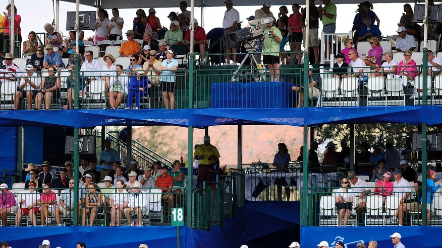 The stands are seen packed on 18 during the final and fourth round of the CME Group Titleholders LPGA golf tournament Sunday, Nov. 24, 2013 at Tiburon Golf Club in Naples, Fla. China's Shanshan Feng took home the top prize of $700,000 shooting a 15-under par for the tournament. USA's Gerina Piller placed second at 14-under par taking home $139,713. Rounding out third place was Thailand's Pornanog Phatlum at 13-under par taking home $101,352. (AP Photo/Naples Daily News, Corey Perrine)