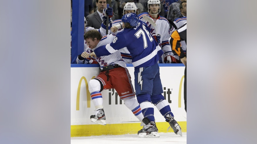Tampa Bay Lightning left wing Pierre-Cedric Labrie (76) fights with New York Rangers right wing Derek Dorsett during the first period of an NHL hockey game Monday, Nov. 25, 2013, in Tampa, Fla. Both players received five-minute majors for fighting. (AP Photo/Chris O'Meara)