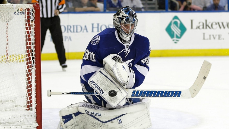 Tampa Bay Lightning goalie Ben Bishop makes a blocker save on a shot by the New York Rangers during the first period of an NHL hockey game Monday, Nov. 25, 2013, in Tampa, Fla. (AP Photo/Chris O'Meara)