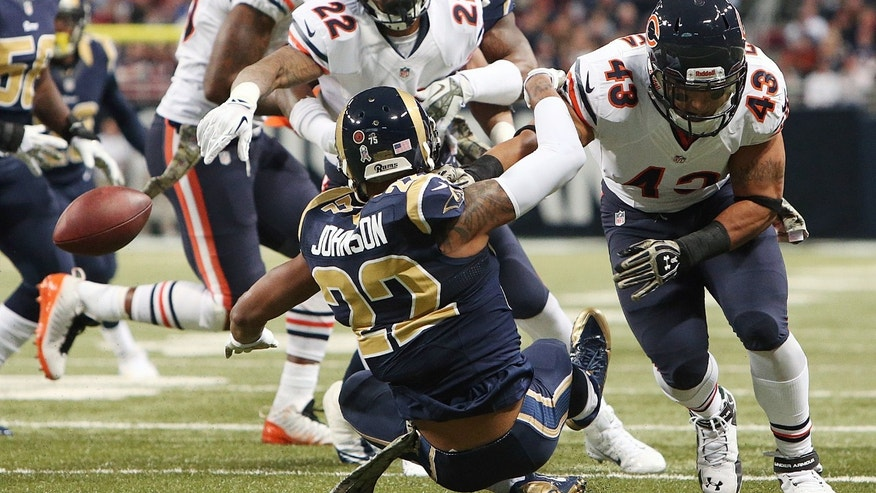 St. Louis Rams cornerback Trumaine Johnson (22) forces a fumble by Chicago Bears running back Matt Forte (22) during the first half of an NFL football game on Sunday, Nov. 24, 2013, in St. Louis. (AP Photo/St. Louis Post-Dispatch, Chris Lee)  EDWARDSVILLE INTELLIGENCER OUT; THE ALTON TELEGRAPH OUT