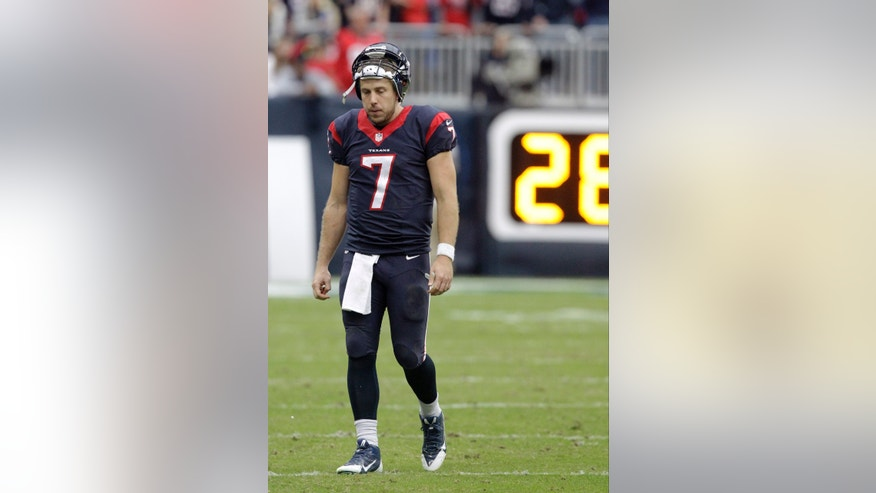 Houston Texans quarterback Case Keenum (7) walks off the field against the Jacksonville Jaguars during the fourth quarter of an NFL football game Sunday, Nov. 24, 2013, in Houston. (AP Photo/Patric Schneider)
