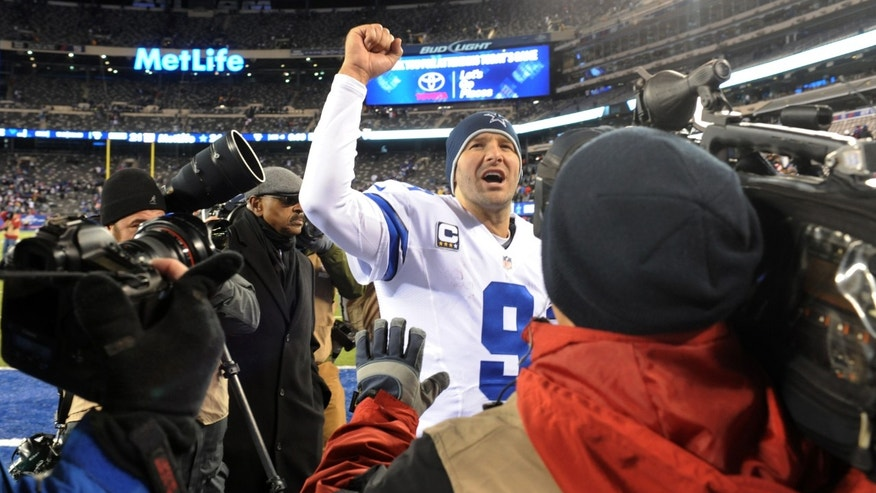 Dallas Cowboys quarterback Tony Romo (9) gestures while leaving the field after an NFL football game against the New York Giants, Sunday, Nov. 24, 2013, in East Rutherford, N.J. The Cowboys won 24-21. (AP Photo/Bill Kostroun)