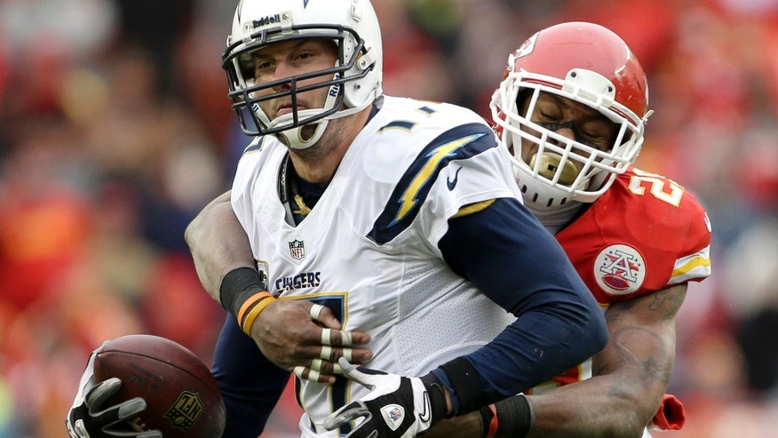 San Diego Chargers quarterback Philip Rivers (17) is sacked by Kansas City Chiefs strong safety Eric Berry (29) during the second half of an NFL football game on Sunday, Nov. 24, 2013, in Kansas City, Mo. The Chargers won the game 41-38. (AP Photo/Charlie Riedel)