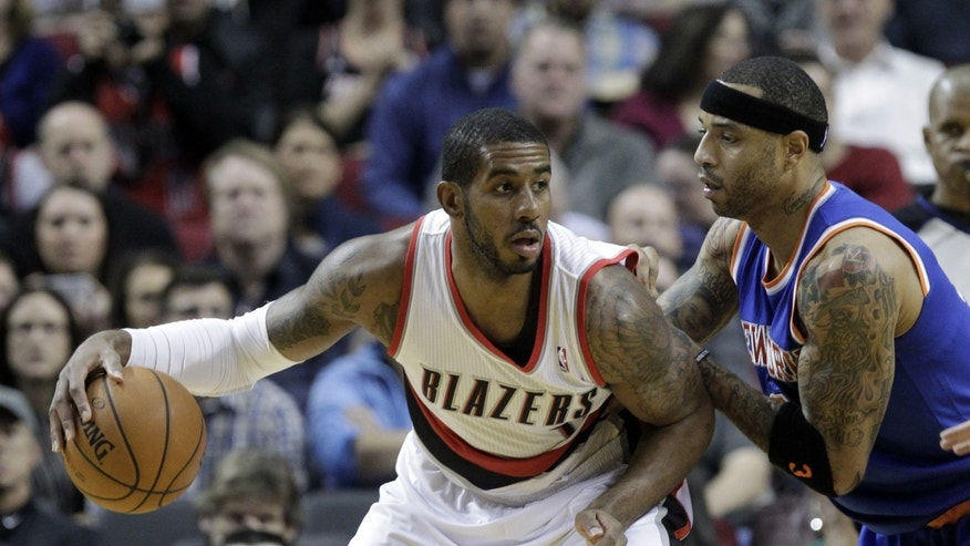 Portland Trail Blazers forward LaMarcus Aldridge, left, backs in on New York Knicks forward Kenyon Martin during the first half of an NBA basketball game in Portland, Ore., Monday, Nov. 25, 2013.(AP Photo/Don Ryan)