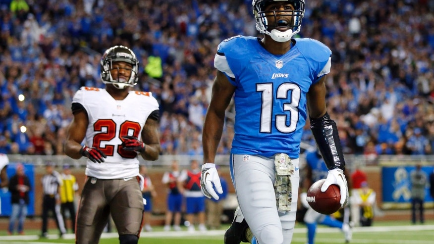 Detroit Lions wide receiver Nate Burleson (13) beats Tampa Bay Buccaneers defensive back Rashaan Melvin (28) for a 5-yard touchdown reception during the second quarter of an NFL football game at Ford Field in Detroit, Sunday, Nov. 24, 2013. (AP Photo/Rick Osentoski)