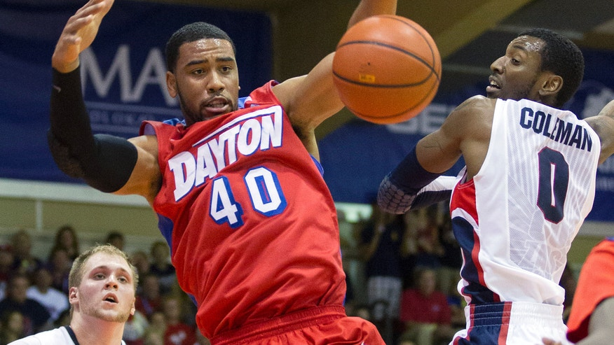 Dayton forward Devon Scott (40) battles Gonzaga guard Gerard Coleman (0) for a rebound as his teammate center Przemek Karnowski (24) looks on in the first half of an NCAA college basketball game at the Maui Invitational on Monday, Nov. 25, 2013, in Lahaina, Hawaii. (AP Photo/Eugene Tanner)