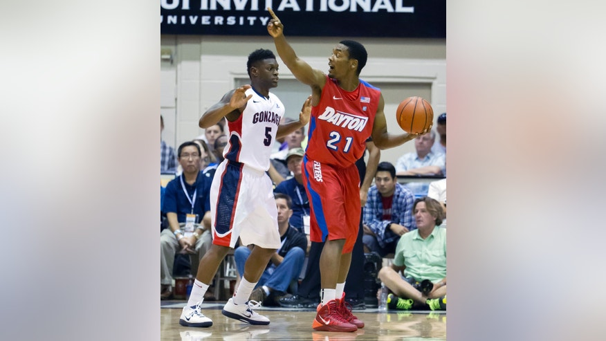 Gonzaga guard Gary Bell, Jr. (5) defends Dayton forward Dyshawn Pierre (21) as he directs the Dayton team in the first half of an NCAA college basketball game at the Maui Invitational on Monday, Nov. 25, 2013, in Lahaina, Hawaii. (AP Photo/Eugene Tanner)