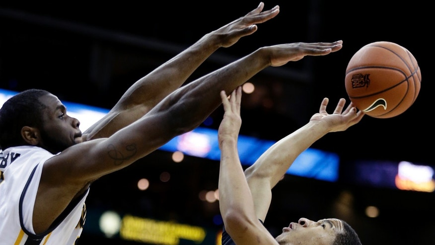 Wichita State's Kadeem Coleby, left, blocks a shot by DePaul's Billy Garrett Jr. (5) during the second half of an NCAA college basketball game Monday, Nov. 25, 2013, in Kansas City, Mo. Wichita State won the game 90-72. (AP Photo/Charlie Riedel)