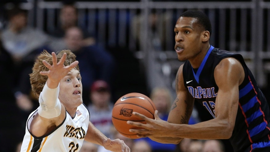 Wichita State's Ron Baker (31) pressures DePaul's Cleveland Melvin (12) during the first half of an NCAA college basketball game Monday, Nov. 25, 2013, in Kansas City, Mo. (AP Photo/Charlie Riedel)