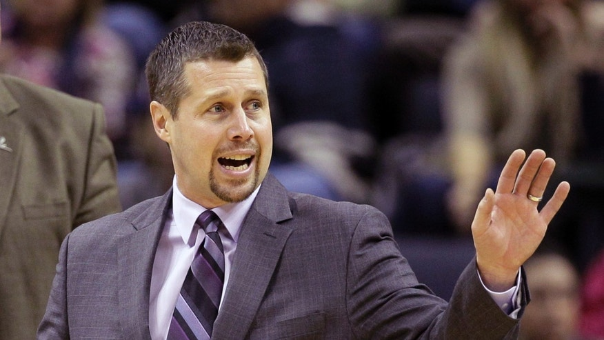 Memphis Grizzlies coach David Joerger motions to players during a timeout in the second half of an NBA basketball game in Memphis, Tenn., Monday, Nov. 25, 2013. The Rockets defeated the Grizzlies 93.86. (AP Photo/Danny Johnston)