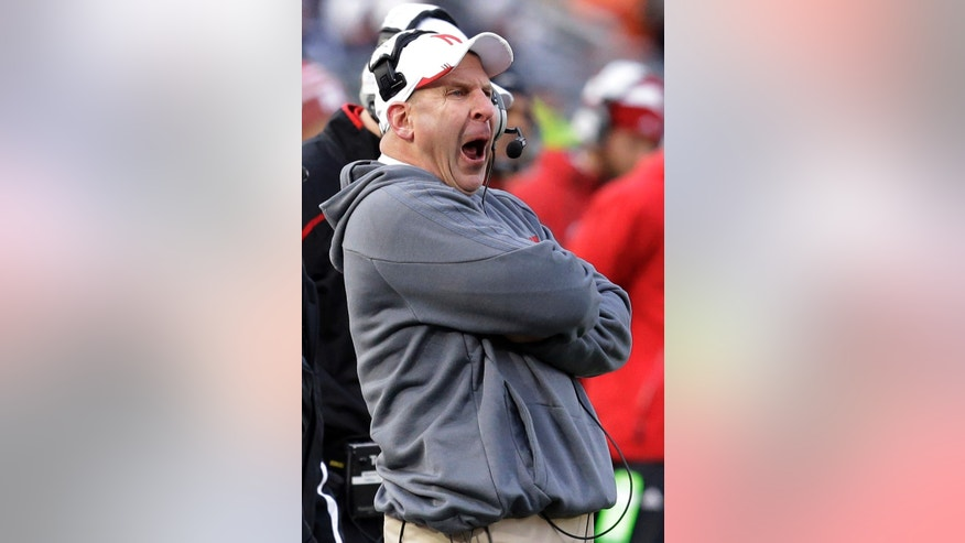 Nebraska head coach Bo Pelini yells from the sidelines during the first quarter of an NCAA college football game against Penn State in State College, Pa., Saturday, Nov. 23, 2013. (AP Photo/Gene J. Puskar)