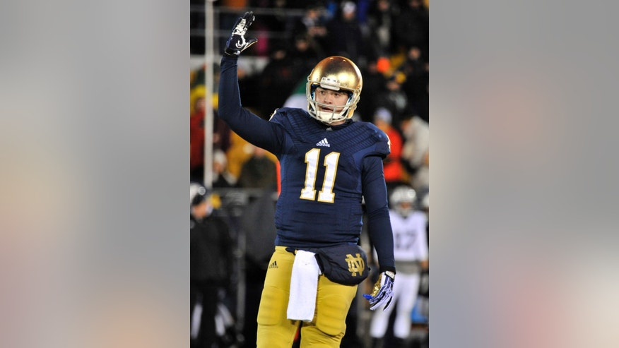 Notre Dame quarterback Tommy Rees encourages the students in the final seconds of the second half of an NCAA college football game Saturday, Nov. 23, 2013, in South Bend, Ind. Notre Dame won 23-13.  (AP Photo/Joe Raymond)