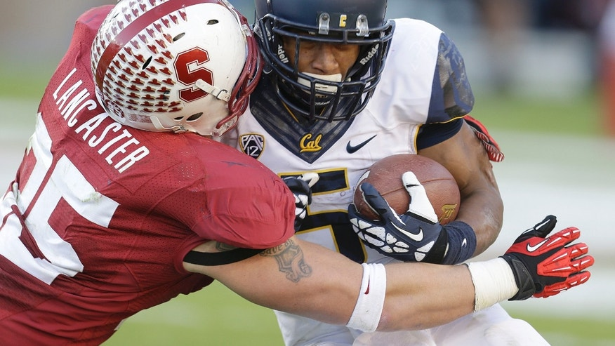 California running back Brendan Bigelow (5) is tackled for a loss by Stanford linebacker Jarek Lancaster (35) during the second half of an NCAA college football game in Stanford, Calif., Saturday, Nov. 23, 2013. Stanford won 65-13. (AP Photo/Tony Avelar)