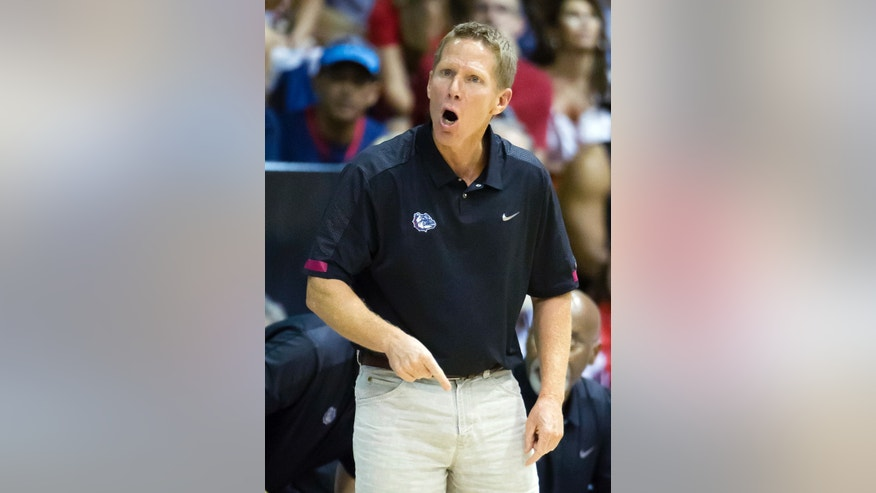 Gonzaga head coach Mark Few shouts to his team while playing Dayton in the first half of an NCAA college basketball game at the Maui Invitational on Monday, Nov. 25, 2013, in Lahaina, Hawaii. (AP Photo/Eugene Tanner)