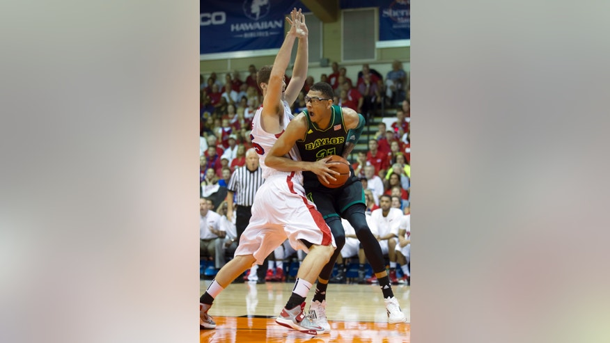 Baylor center Isaiah Austin (21) looks for a teammate to pass off to while being defended by Dayton center Matt Kavanaugh (35) in the first half of an NCAA college basketball game at the Maui Invitational on Tuesday, Nov. 26, 2013, in Lahaina, Hawaii. (AP Photo/Eugene Tanner)