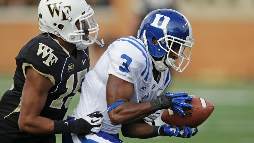 Duke wide receiver Jamison Crowder (3) catches a touchdown pass as Wake Forest cornerback Allen Ramsey (15) defends during the second half of an NCAA college football game in Winston-Salem, N.C., Saturday, Nov. 23, 2013. Duke won 28-21. (AP Photo/Chuck Burton)