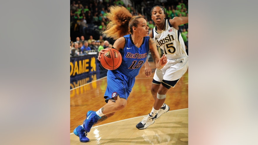 DePaul guard Brittany Hrynko, left, drives the lane as Notre Dame guard Lindsay Allen defends during the first half of an NCAA college basketball game, Tuesday, Nov. 26, 2013, in South Bend, Ind.  (AP Photo/Joe Raymond)