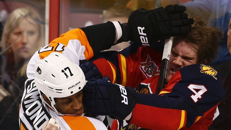 Philadephia Flyers's Wayne Simmonds (17) and Florida Panthers's Dylan Olsen (4) fight during the third period of an NHL hockey game in Sunrise, Fla., Monday, Nov. 25, 2013. The Panthers won 3-1. (AP Photo/J Pat Carter)