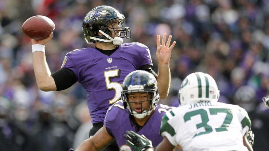 Baltimore Ravens quarterback Joe Flacco passes the ball as running back Ray Rice keeps New York Jets free safety Jaiquawn Jarrett (37) away during the first half of an NFL football game in Baltimore, Md., Sunday, Nov. 24, 2013. (AP Photo/Patrick Semansky)