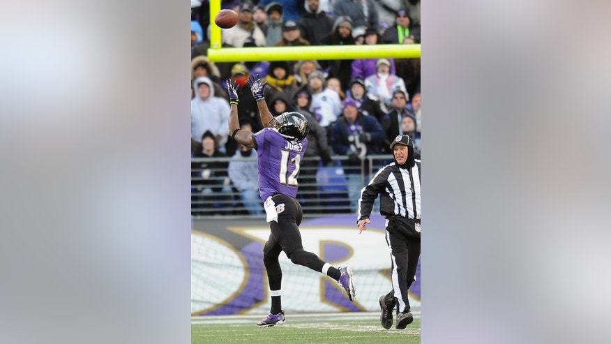 Baltimore Ravens wide receiver Jacoby Jones reaches for a touchdown pass from quarterback Joe Flacco during the second half of an NFL football game against the New York Jets in Baltimore, Sunday, Nov. 24, 2013. (AP Photo/Nick Wass)