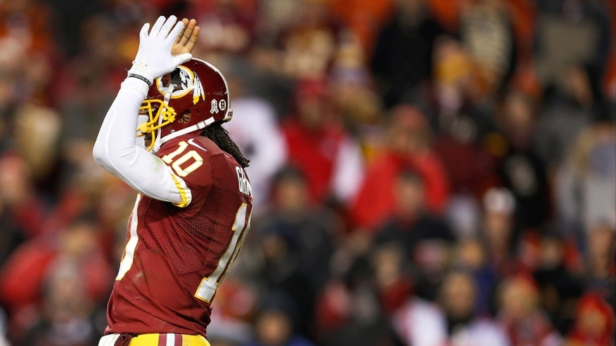 Washington Redskins quarterback Robert Griffin III reacts to an unsuccessful play during the second half of an NFL football game against the San Francisco 49ers in Landover, Md., Monday, Nov. 25, 2013. The 49ers defeated the Redskins 27-6. (AP Photo/Evan Vucci)