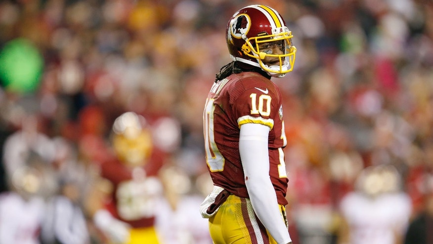 Washington Redskins quarterback Robert Griffin III looks back at the bench during the first half of an NFL football game against the San Francisco 49ers in Landover, Md., Monday, Nov. 25, 2013. The 49ers defeated the Redskins 27-6. The Redskins loss drops them to 3-8 for the season.  (AP Photo/Evan Vucci)