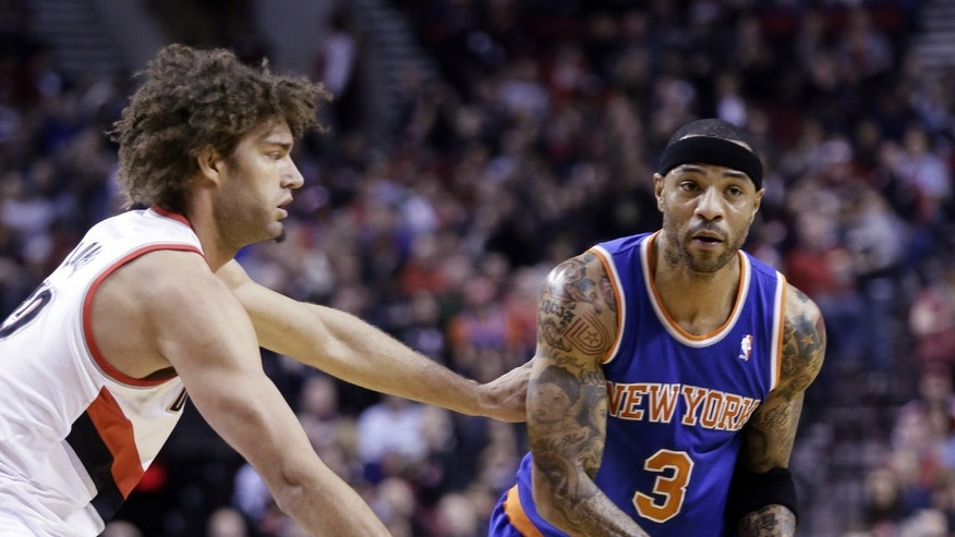 Portland Trail Blazers center Robin Lopez, left, defends on New York Knicks forward Kenyon Martin during the first half of an NBA basketball game in Portland, Ore., Monday, Nov. 25, 2013.(AP Photo/Don Ryan)