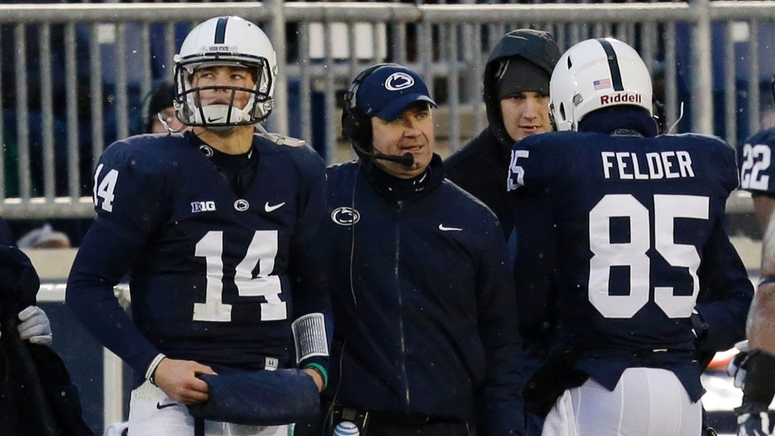 Penn State quarterback Christian Hackenberg (14) stands on the sidelines next to Penn State head coach Bill O' Brien during the second quarter of an NCAA college football game against Nebraska  in State College, Pa., Saturday, Nov. 23, 2013. (AP Photo/Gene J. Puskar)