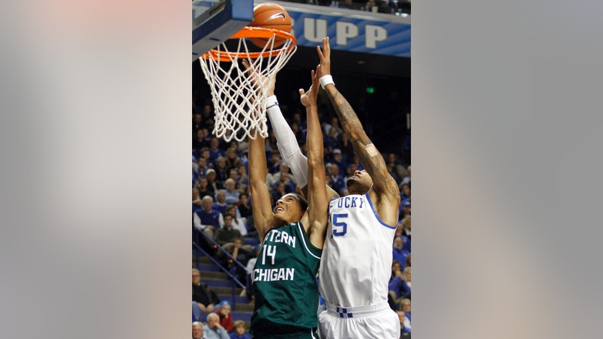 Kentucky's Willie Cauley-Stein (15) and Eastern Michigan's Karrington Ward (14) go after a rebound during the first half of an NCAA college basketball game, Wednesday, Nov. 27, 2013, in Lexington, Ky. (AP Photo/James Crisp)