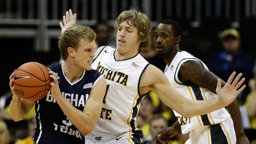 Wichita State's Ron Baker pressures Brigham Young's Tyler Haws (3) during the first half of an NCAA college basketball game Tuesday, Nov. 26, 2013, in Kansas City, Mo. (AP Photo/Charlie Riedel)