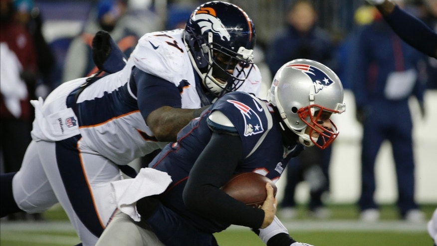 Denver Broncos defensive tackle Kevin Vickerson (99) sacks New England Patriots quarterback Tom Brady (12) in the first quarter of an NFL football game Sunday, Nov. 24, 2013, in Foxborough, Mass. (AP Photo/Stephan Savoia)