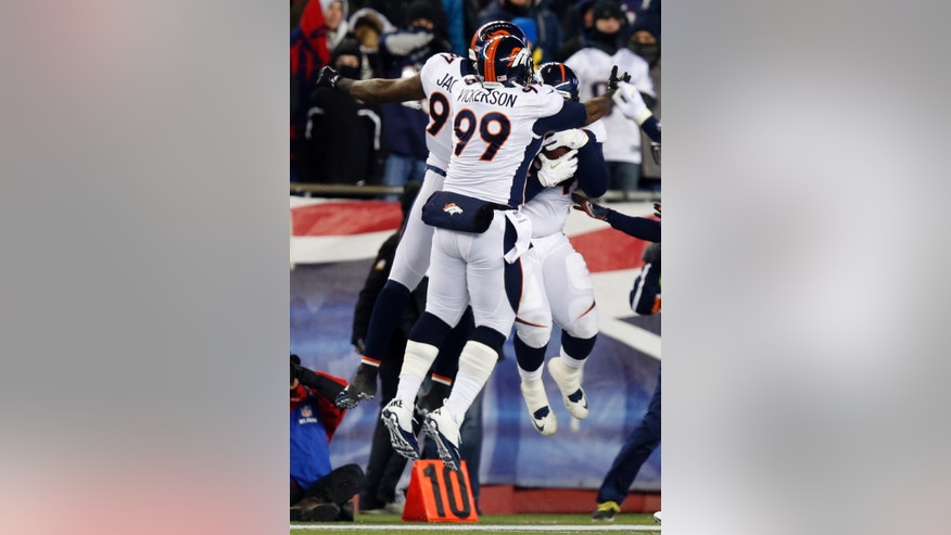 Denver Broncos' Kevin Vickerson (99) celebrates a fumble recovery by Terrance Knighton, right, in the first quarter of an NFL football game against the New England Patriots Sunday, Nov. 24, 2013, in Foxborough, Mass. (AP Photo/Elise Amendola)