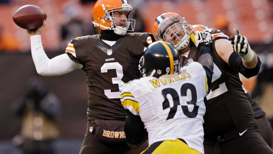 Cleveland Browns quarterback Brandon Weeden (3) throws against the Pittsburgh Steelers in the fourth quarter of an NFL football game Sunday, Nov. 24, 2013, in Cleveland. Weeden's pass was intercepted by Steelers cornerback William Gay and returned for a touchdown. (AP Photo/Tony Dejak)