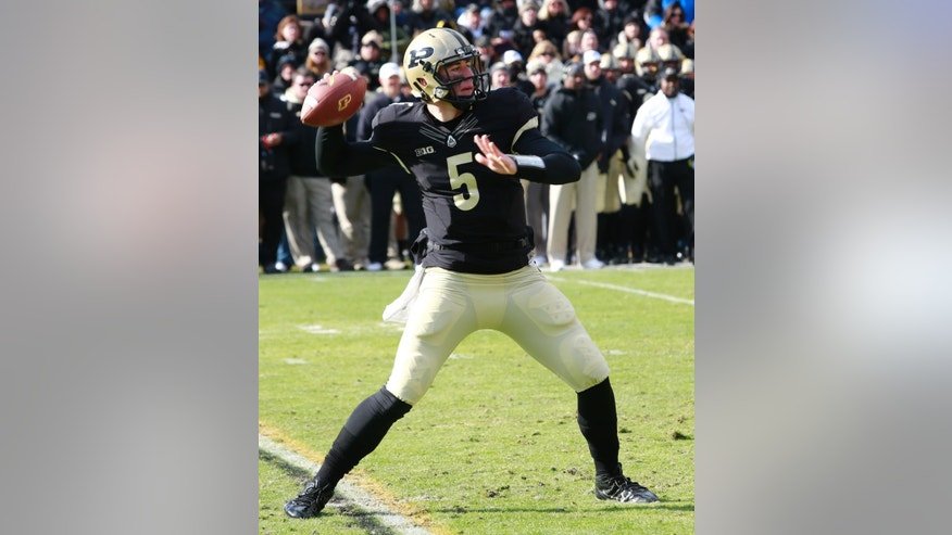 Purdue quarterback Danny Etling throws a pass against Illinois in the first half of an NCAA college football game in West Lafayette, Ind., Saturday, Nov. 23, 2013. (AP Photo/R Brent Smith)
