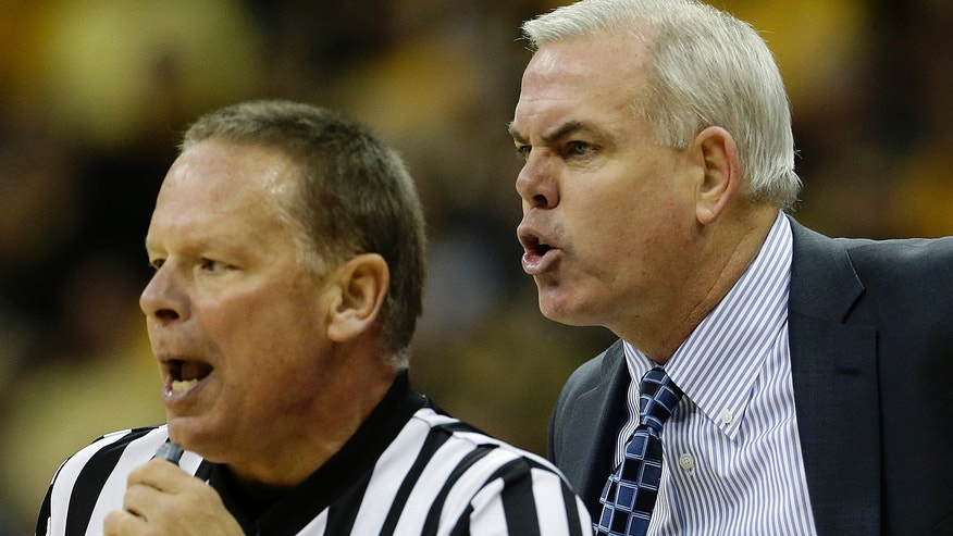 Brigham Young coach Dave Rose argues a call with an official during the first half of an NCAA college basketball game against Wichita State Tuesday, Nov. 26, 2013, in Kansas City, Mo. (AP Photo/Charlie Riedel)