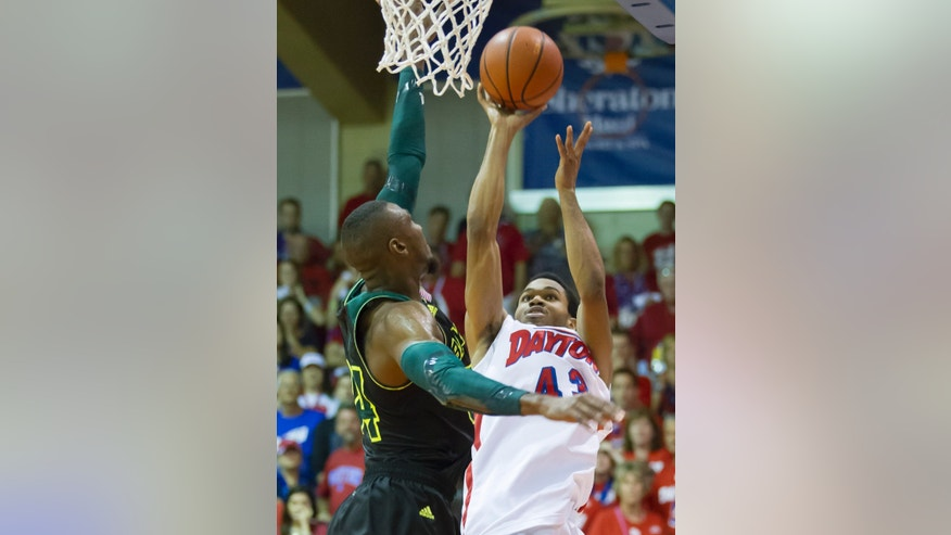 Dayton guard Vee Sanford, right, puts up a last second shot for the win but misses as Baylor forward Cory Jefferson, left, defends late in the second half of an NCAA college basketball game at the Maui Invitational on Tuesday, Nov. 26, 2013, in Lahaina, Hawaii. Baylor won 67-66. (AP Photo/Eugene Tanner)