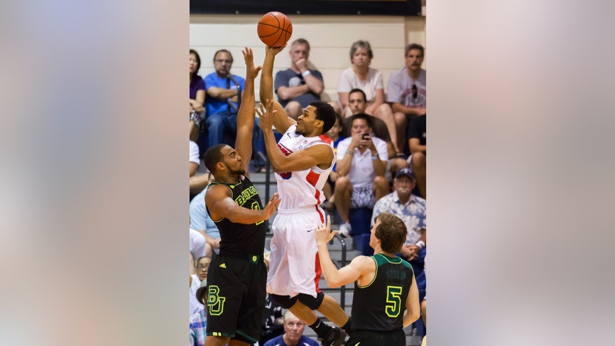 Dayton guard Vee Sanford, right, puts up a shot over Baylor forward Rico Gathers, left, as Baylor guard Brady Heslip (5) looks on in the first half of an NCAA college basketball game at the Maui Invitational on Tuesday, Nov. 26, 2013, in Lahaina, Hawaii. (AP Photo/Eugene Tanner)