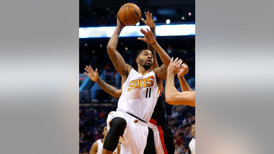 Phoenix Suns' Markieff Morris (11) shoots against the Portland Trail Blazers during the second half of an NBA basketball game, Wednesday, Nov. 27, 2013, in Phoenix. The Suns won 120-106. (AP Photo/Matt York)