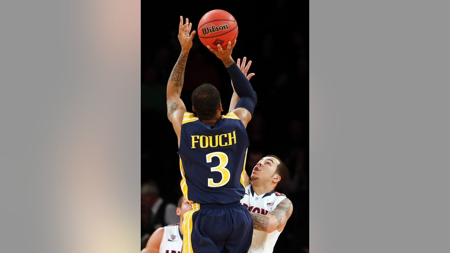 Drexel's Chris Fouch (3) shoots against Arizona's Gabe York during the first half of an NCAA college basketball game in the semifinals of the NIT Season Tip-off tournament Wednesday, Nov. 27, 2013, in New York. (AP Photo/Jason DeCrow)