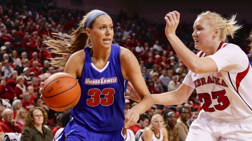 UMass-Lowell's Lindsey Doucette (33) tries to get around Nebraska's Emily Cady (23) in the first half of an NCAA college basketball game in Lincoln, Neb., Wednesday, Nov. 27, 2013. (AP Photo/Nati Harnik)