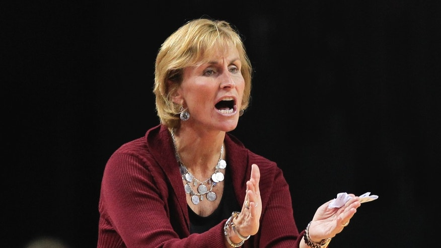 UMass-Lowell coach Sarah Behn urges her players on, in the first half of an NCAA college basketball game against Nebraska in Lincoln, Neb., Wednesday, Nov. 27, 2013. (AP Photo/Nati Harnik)