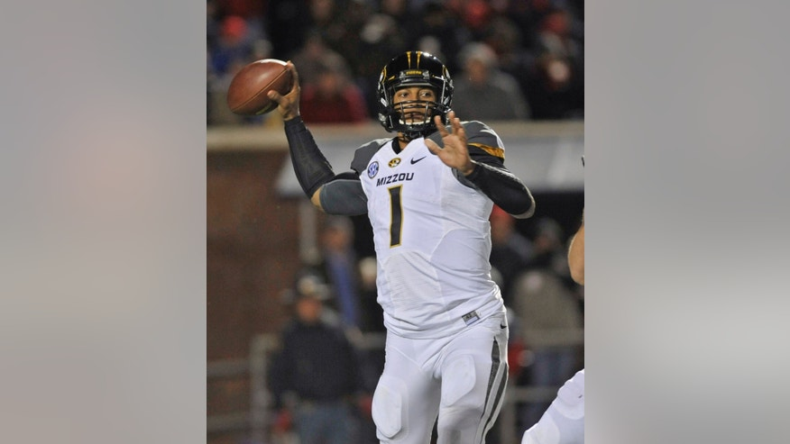 Missouri quarterback James Franklin (1) looks for an open receiver during an NCAA college football game against Mississippi on Saturday, Nov. 23, 2013, in Oxford, MS. #8 Missouri beat #24 Mississippi 24-10. (AP Photo/ The Daily Mississippian, Austin McAfee)