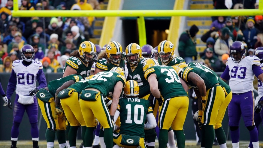 Green Bay Packers quarterback Matt Flynn (10) leads a huddle during the second half of an NFL football game against the Minnesota Vikings Sunday, Nov. 24, 2013, in Green Bay, Wis. The game ended in a tie, 26-26. (AP Photo/Mike Roemer)