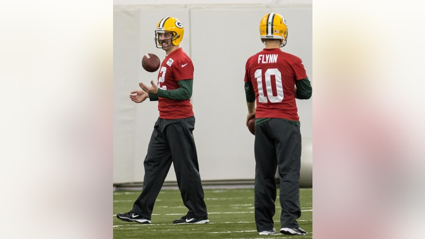Green Bay Packers NFL football quarterback Aaron Rodgers (12) practices in Ashwaubenon, Wisc., on Tuesday, Nov. 26, 2013. At right is Packers quarterback Matt Flynn. (AP Photo/The Green Bay Press-Gazette, Lukas Keapproth) NO SALES