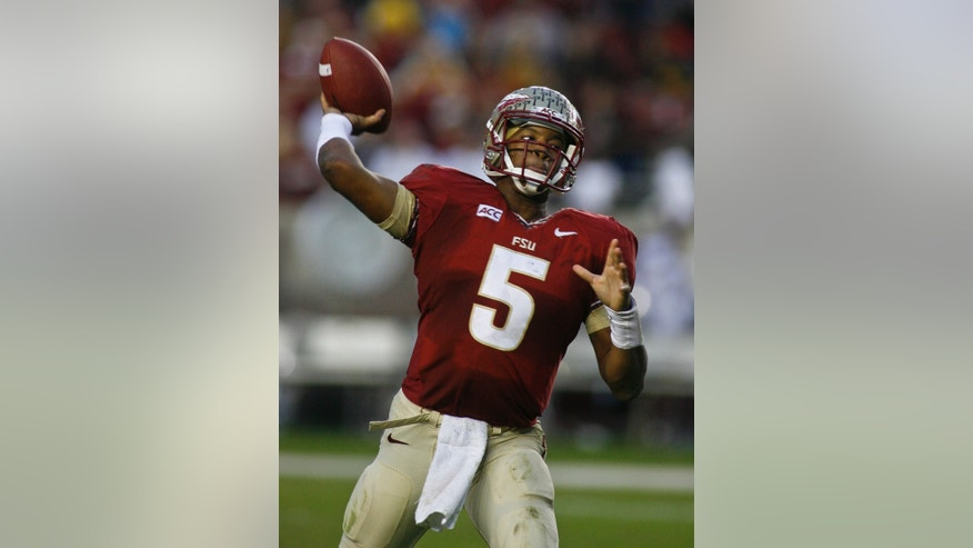 Florida State quarterback Jameis Winston (5) throws in the first half of an NCAA college football game against Idaho on Saturday, Nov. 23, 2013 in Tallahassee, Fla. (AP Photo/Phil Sears)