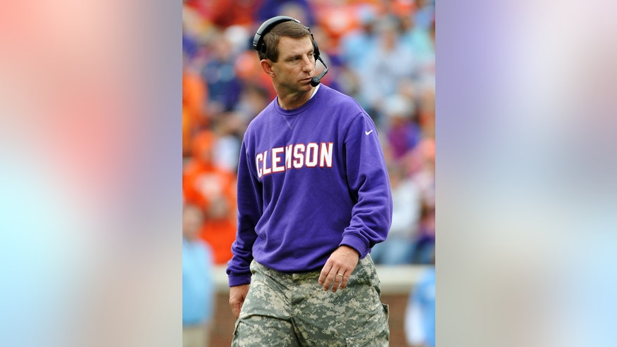 Clemson head coach Dabo Swinney looks on during the second half of an NCAA college football game against The Citadel, Saturday, Nov. 23, 2013, in Clemson, S.C. Clemson won 52-6. (AP Photo/Rainier Ehrhardt)