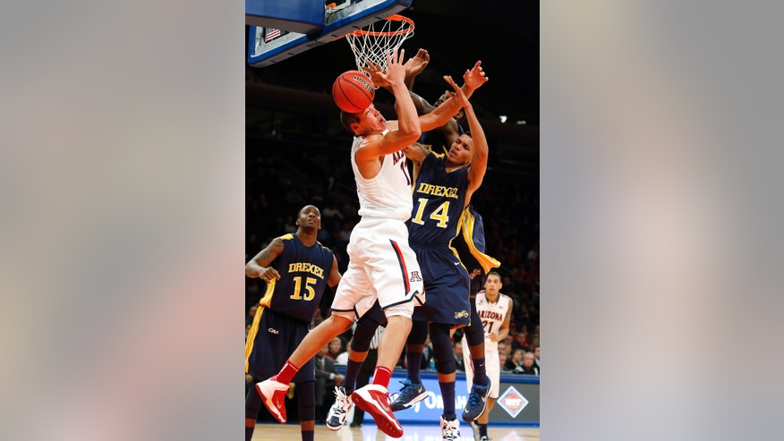 Arizona's Aaron Gordon, left, has a rebound knocked away from him by Drexel's Dartaye Ruffin, behind and Damion Lee (14) during the first half of an NCAA college basketball game in the semifinals of the NIT Season Tip-off tournament Wednesday, Nov. 27, 2013, in New York. (AP Photo/Jason DeCrow)