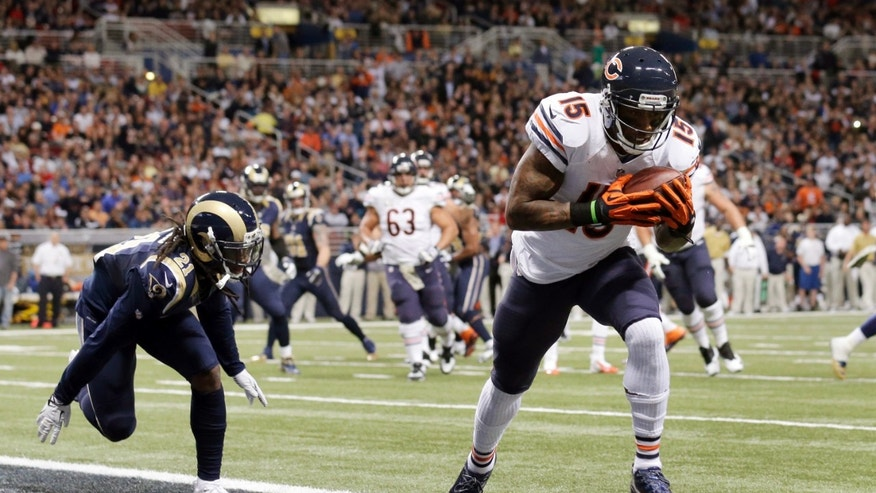 Chicago Bears wide receiver Brandon Marshall, right, catches a 3-yard touchdown pass as St. Louis Rams cornerback Janoris Jenkins defends during the second quarter of an NFL football game on Sunday, Nov. 24, 2013, in St. Louis. (AP Photo/Nam Y. Huh)