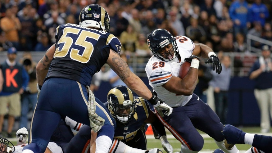 Chicago Bears running back Michael Bush, right, scores on a 1-yard run past St. Louis Rams linebacker James Laurinaitis (55) and safety T.J. McDonald during the fourth quarter of an NFL football game on Sunday, Nov. 24, 2013, in St. Louis. (AP Photo/Nam Y. Huh)